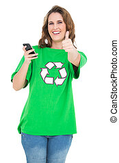 Smiling environmental activist holding phone giving thumbs ...