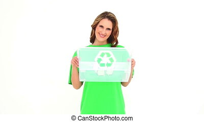 Smiling environmental activist showing empty box on white...