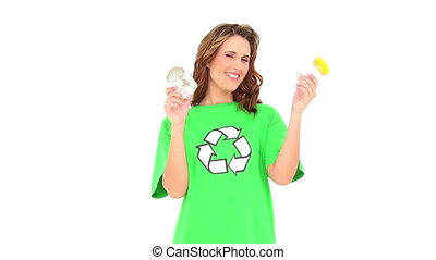 Smiling environmental activist showing jars on white...
