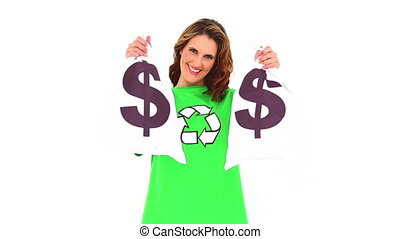 Smiling environmental activist showing money bags on white...