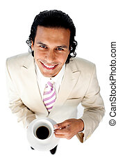 Smiling ethnic businessman drinking a coffee