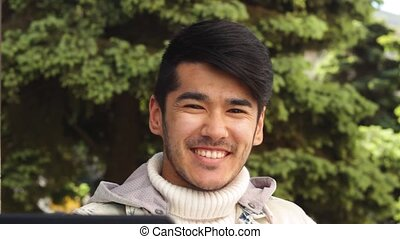 Smiling ethnic man looking in camera and smiling