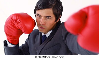 Smiling executive playing with boxing gloves