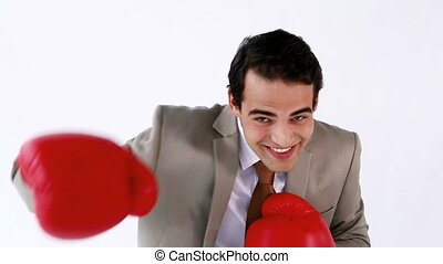 Smiling executive using boxing gloves