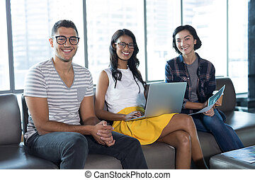 Smiling executives working together in office