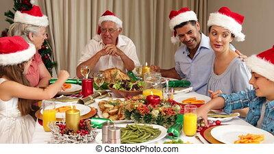 Smiling extended family at christmas dinner