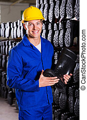 factory worker holding rubber-boot