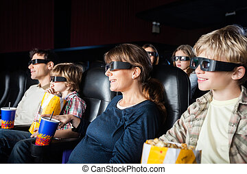 Smiling Families Watching 3D Movie In Theater