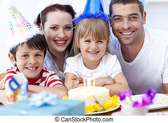 Smiling family celebrating a birthday