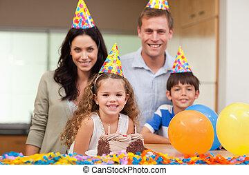 Smiling family celebrating birthday