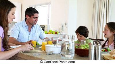 Smiling family having dinner together