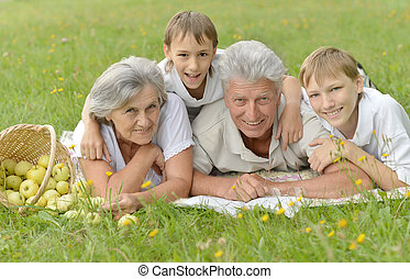 Smiling family on grass