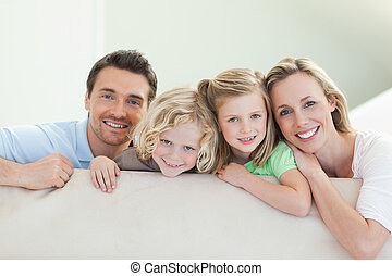 Smiling family on the couch