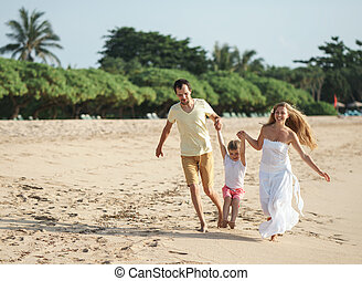 Smiling family outdoors