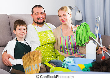 Smiling family ready to clean house - Portrait of friendly ...