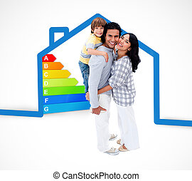 Smiling family standing with a blue house illustration with energy rating graphic on a white background