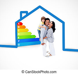 Smiling family standing with a blue house illustration with energy rating on a white background