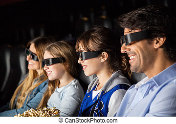 Smiling Family Watching 3D Movie In Theater