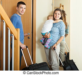 Smiling family with luggage