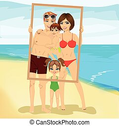 Smiling family with son and daughter looking through an empty frame at beach