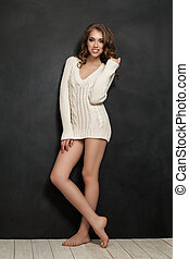 Smiling Fashion Model Woman Standing on Black Wall Background