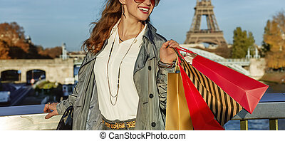 smiling fashion-monger looking into distance in Paris, France