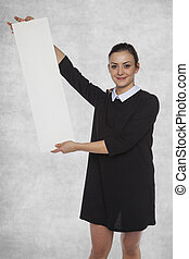 Smiling fashion woman holding a blank billboard, copy space