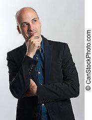 fashionable bald man thinking