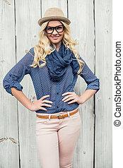 Smiling fashionable blonde posing outdoors