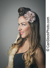 Smiling fashionable woman with fancy hairstyle