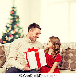 smiling father and daughter looking at each other - family,...