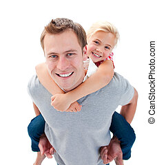 Smiling father giving his daughter piggyback ride