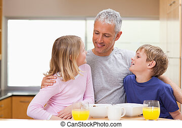 Smiling father with his children in the morning