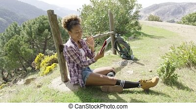 Smiling female backpacker using tablet - Happy cheerful...