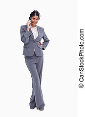Smiling female call center agent with her legs crossed