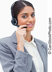 Smiling female call center agent with her headset