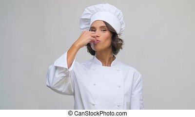 smiling female chef making delicious gesture - cooking, ...