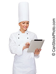 smiling female chef with tablet pc computer