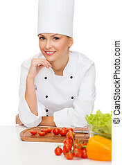 smiling female chef with vegetables