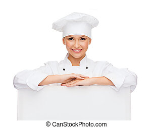 smiling female chef with white blank board - cooking,...