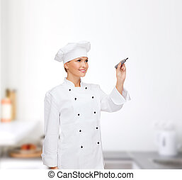 smiling female chef writing something on air - cooking, new...