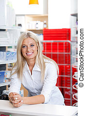 Smiling Female Chemist at Counter