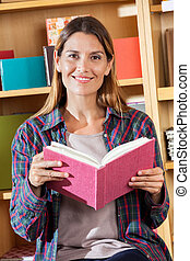Smiling Female Customer Holding Notebook In Store