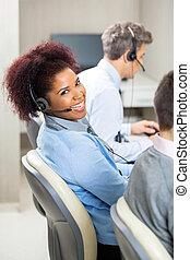 Smiling Female Customer Service Representative In Office -...