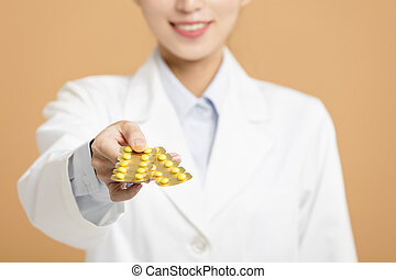 smiling female doctor giving pills