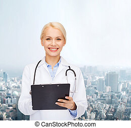 smiling female doctor with clipboard