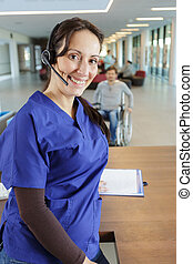 smiling female doctor working at office desk