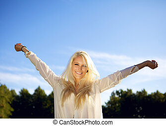 Smiling female enjoying a summer day