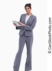 Smiling female entrepreneur with her tablet computer