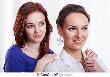 Smiling female friends